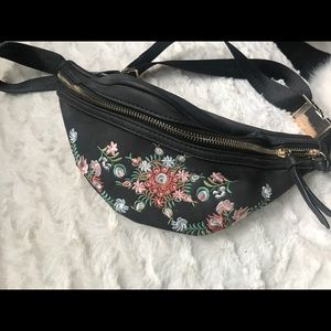 Never been used embroidered fanny pack.